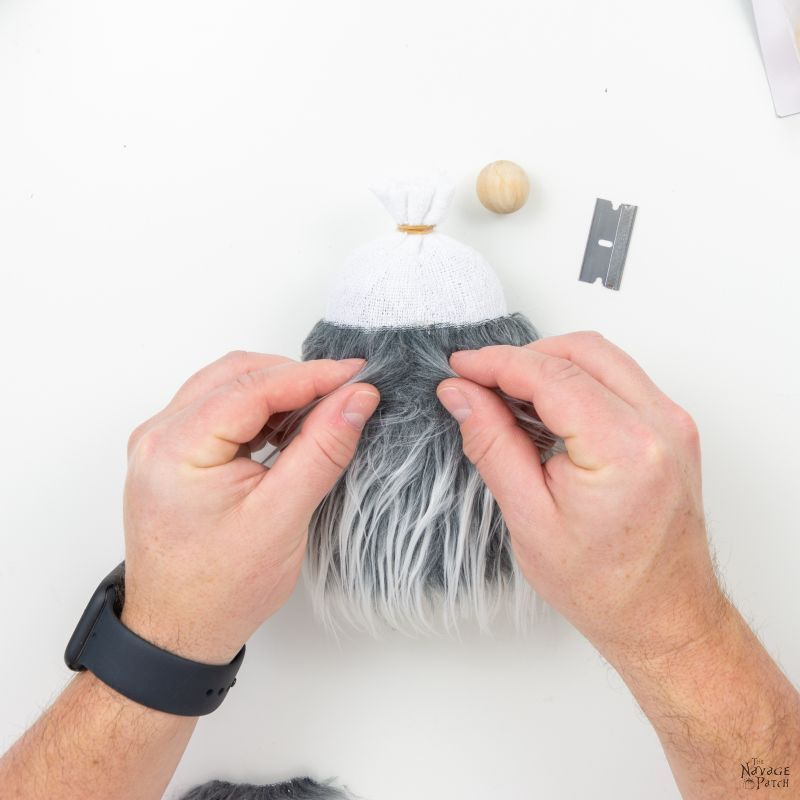 making diy christmas gnomes from a sock and beans