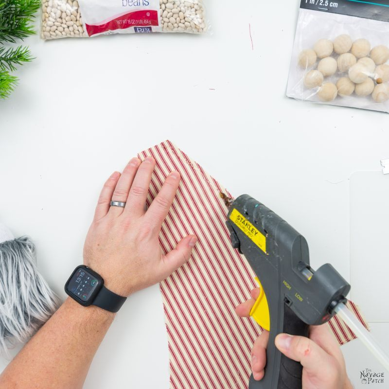 gluing fabric to make a hat for a diy gnome