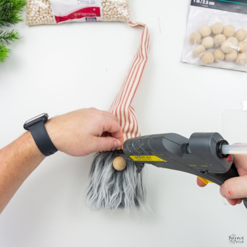 gluing a hat on diy christmas gnome