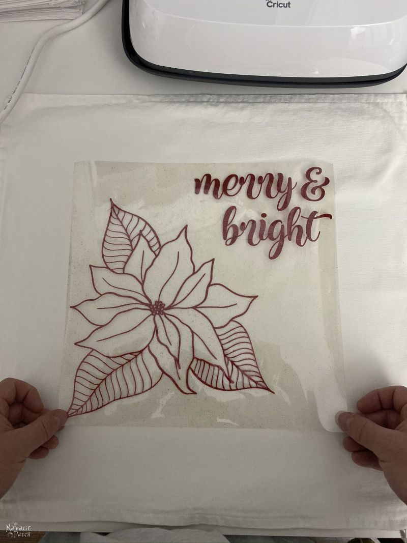 placing heat transfer vinyl onto a pillow cover