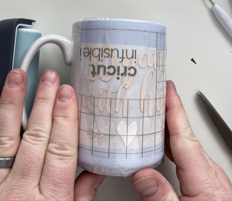 putting infusible ink transfer sheet design on a mug