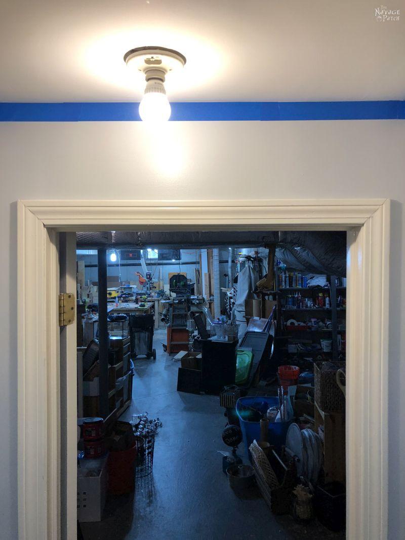 off center light bulb over a basement door