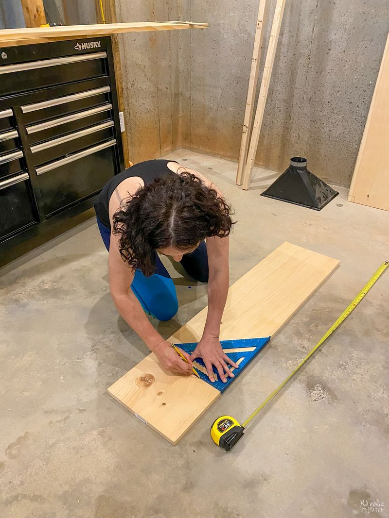 measure and marking lumber with a speed square
