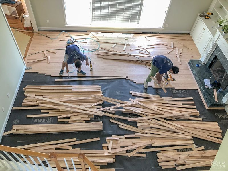 two men installing a hardwood floor