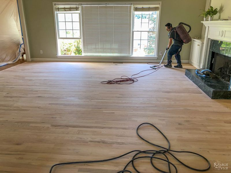 vacuuming a new hardwood floor installation before staining
