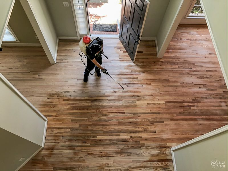 applying pre-stain to a new hardwood floor installation before staining