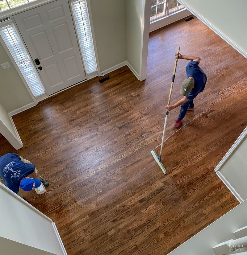 applying finish to a hardwood floor.