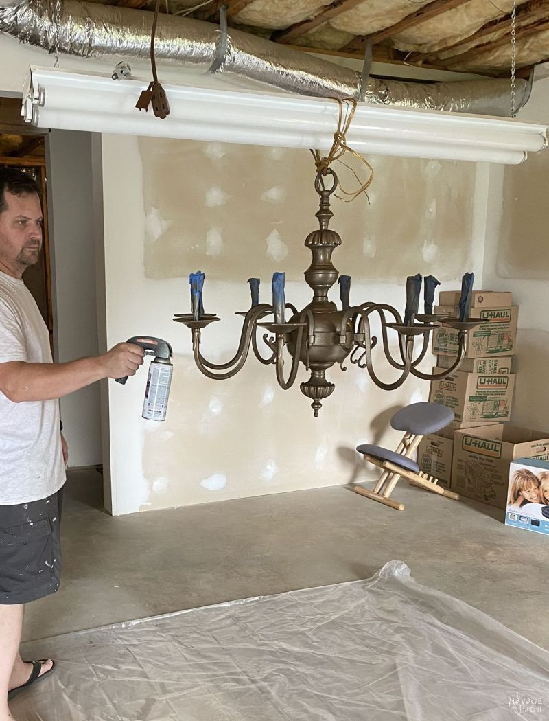 spray painting a DIY Chandelier makeover