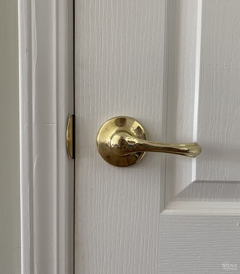 brass door handle on closet door