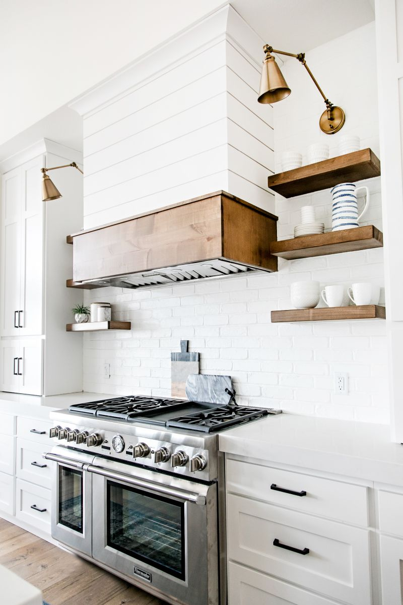 kitchen with range, hood and open shelves