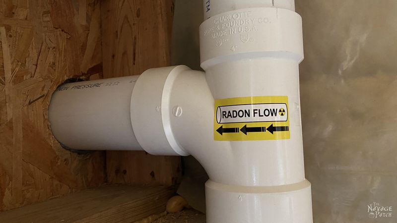 radon collection pipe exiting a basement
