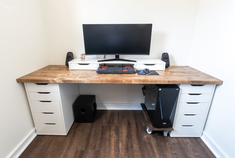 DIY Wall-to-Wall Desk with computer on it