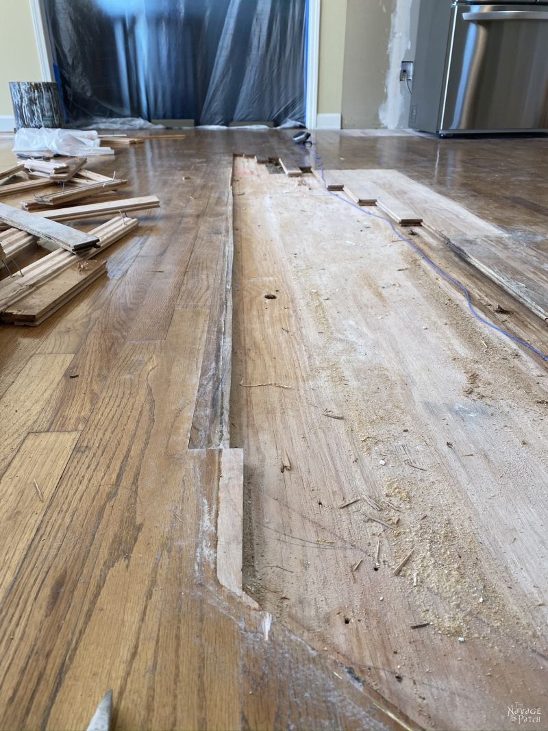 unfinished flooring from where a kitchen island used to be