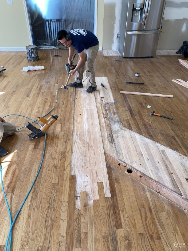 reapairing wood floor in a kitchen remodel