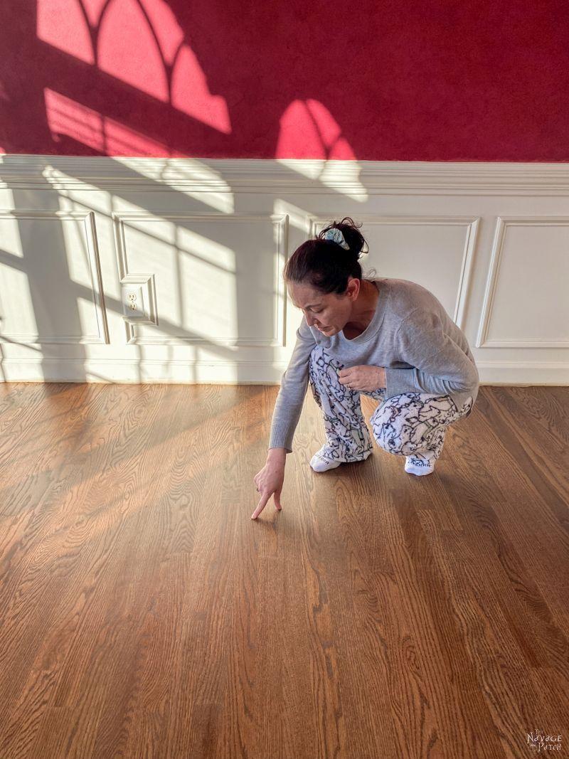 woman kneels on new floor
