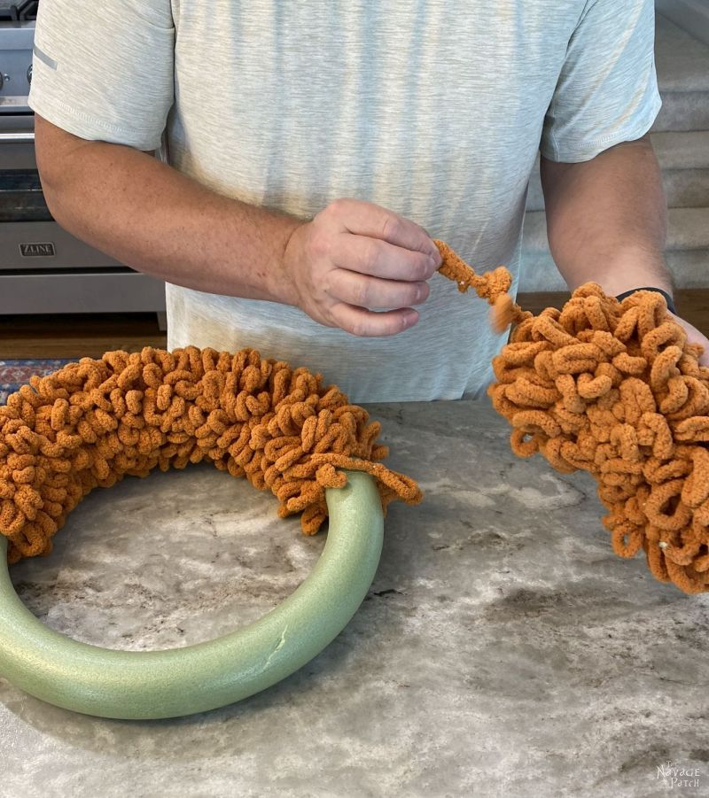 making a diy fall wreath with loop yarn