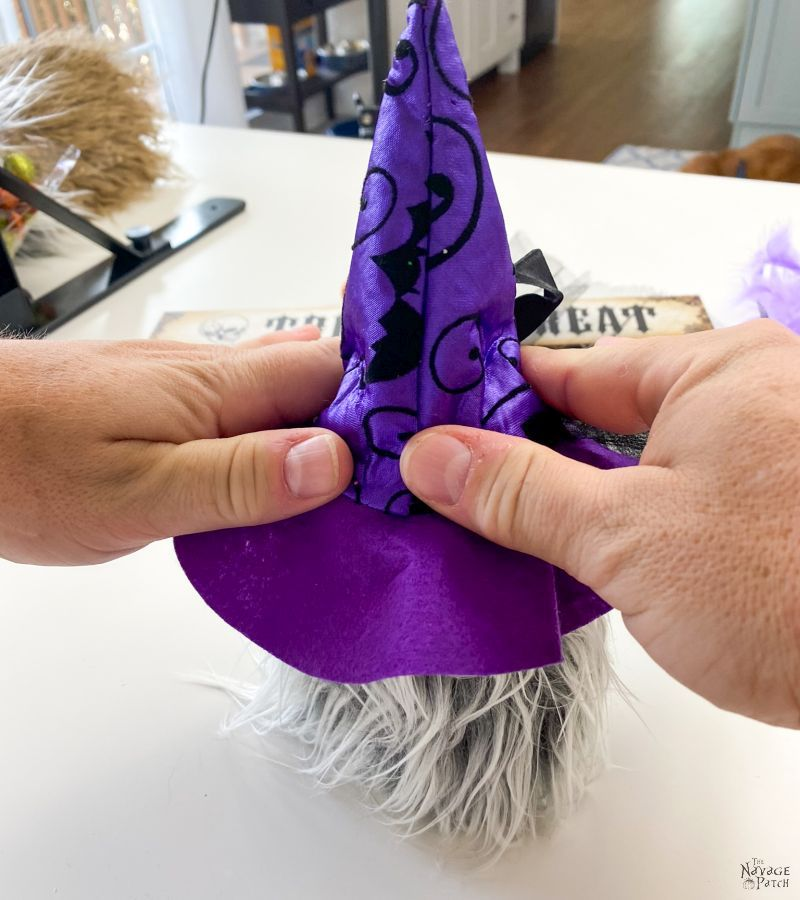 gluing witch hat onto gnome