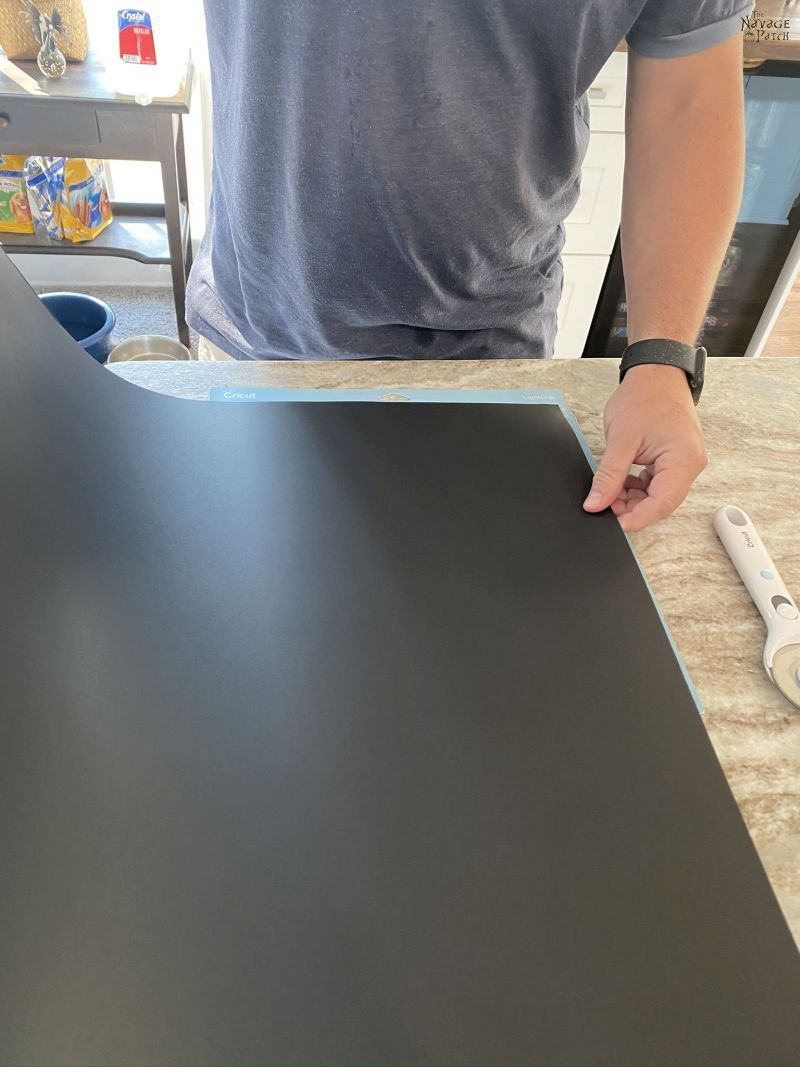measuring and cutting poster board