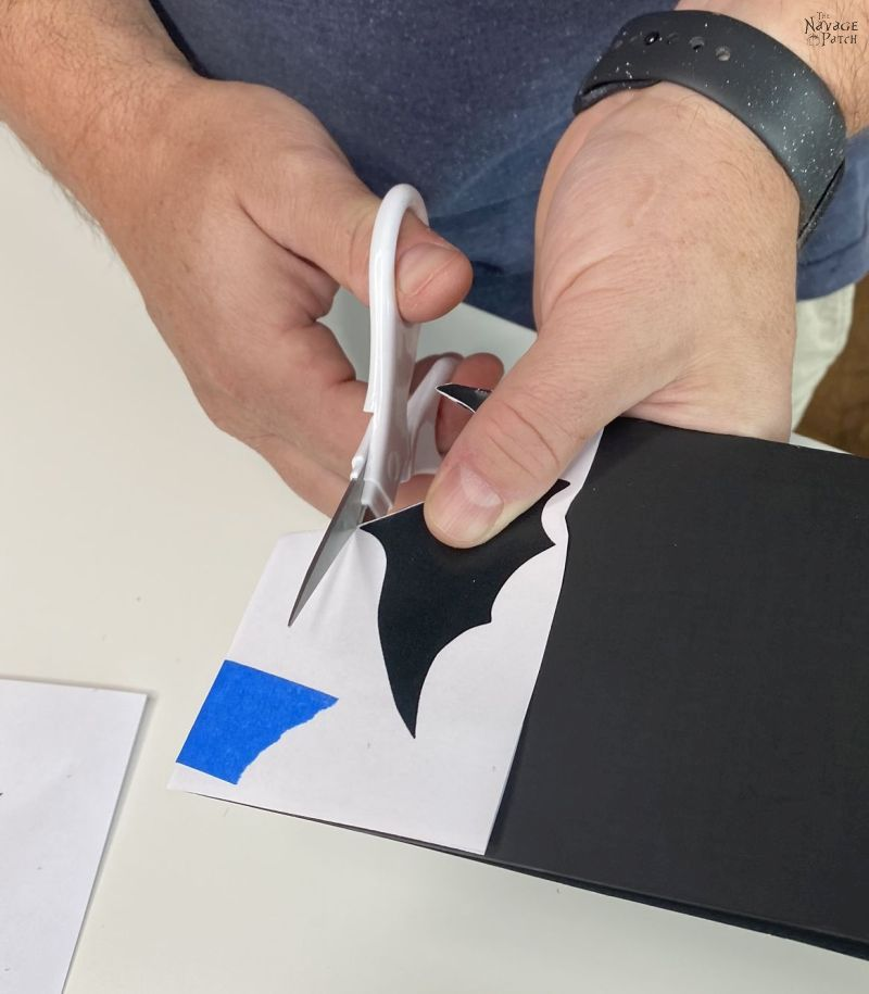 cutting a bat shape from poster board