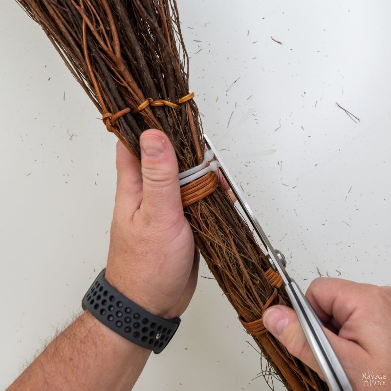 tying the scented brooms together