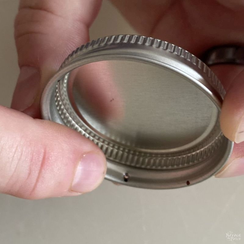 punching hole in lid with an awl