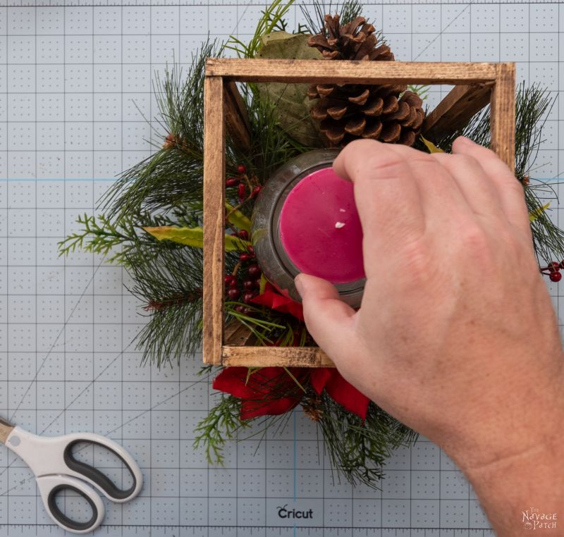 placing a candle in a lantern