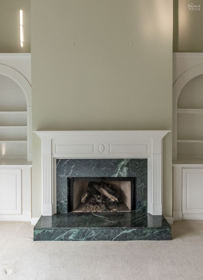 formal fireplace in empty living room
