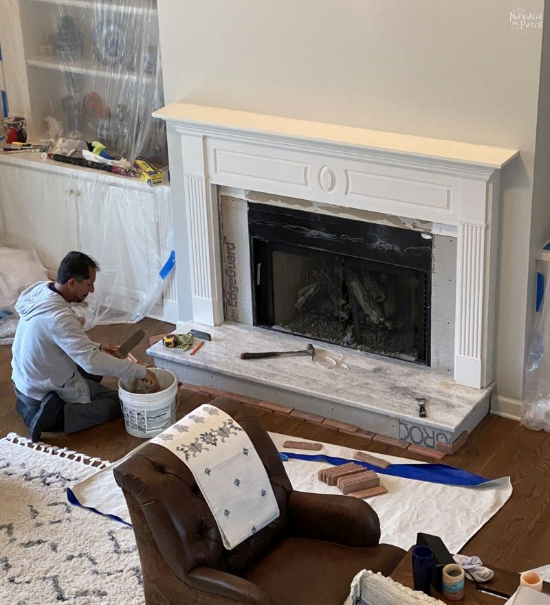 adding brick to a fireplace makeover