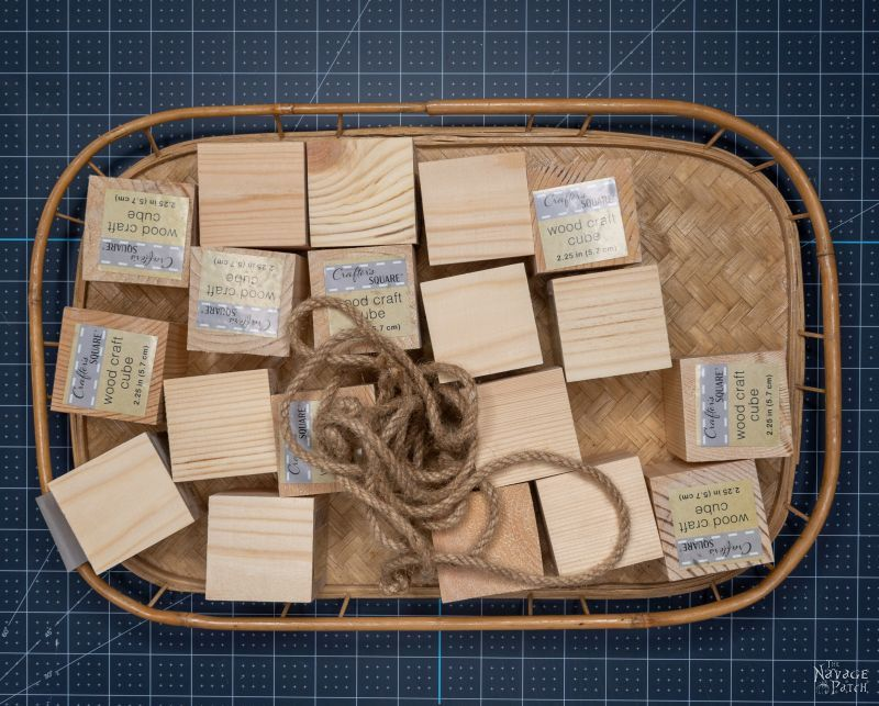 wood blocks on a tray with rope