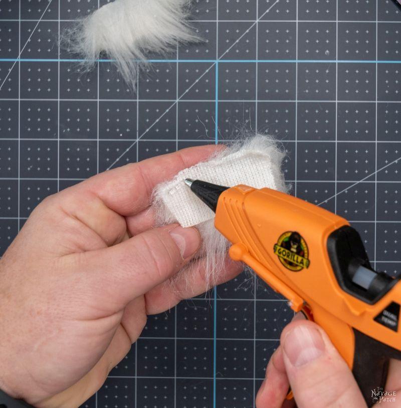 putting hot glue nutcracker hair