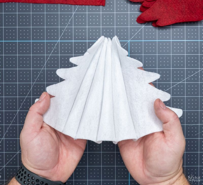 gluing felt pieces together to make a tree