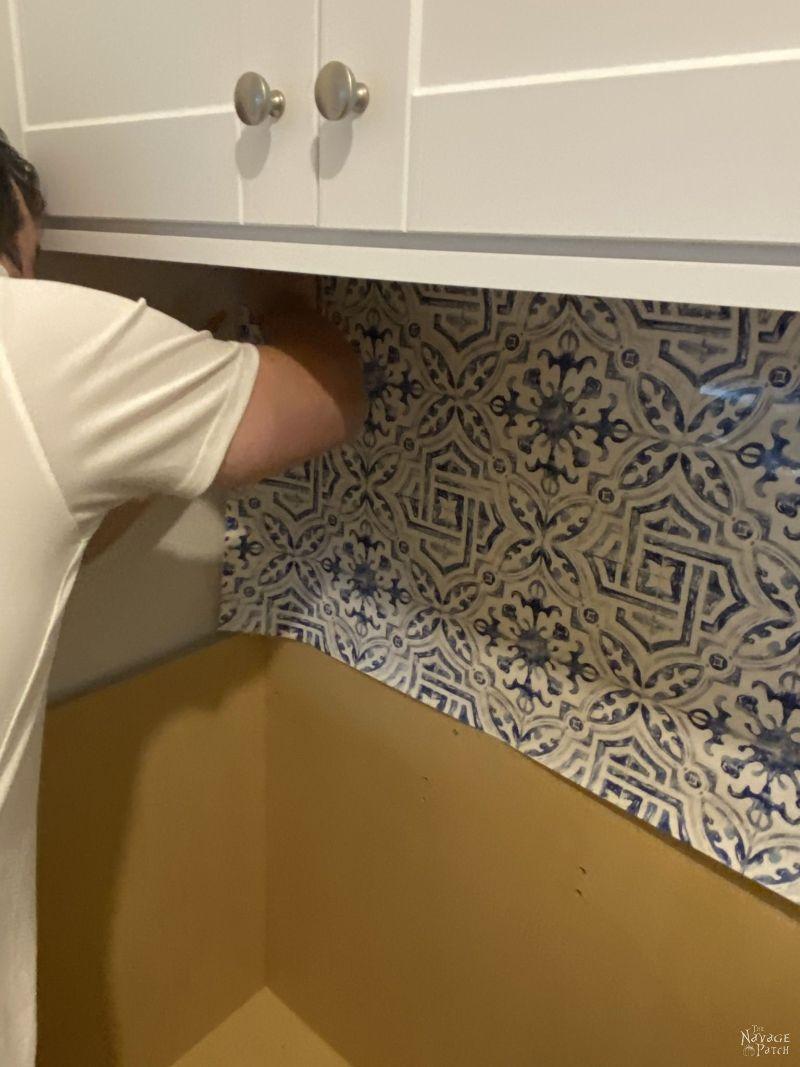 applying wallpaper backsplash