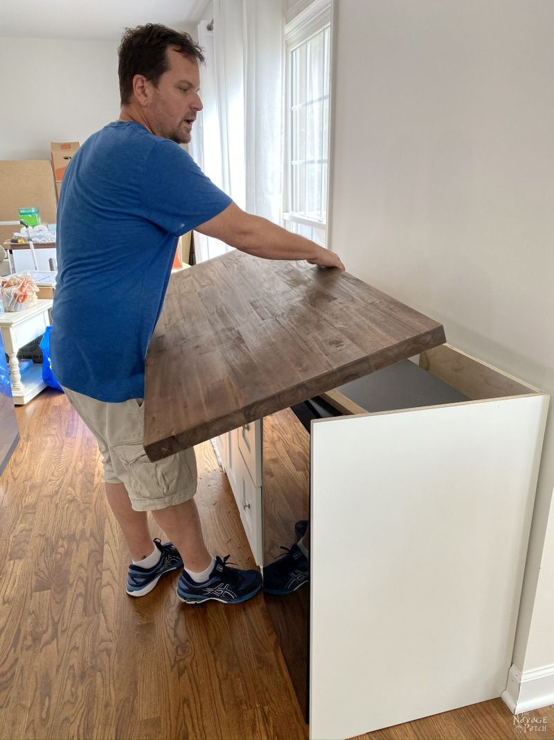 putting a countertop on a cabinet