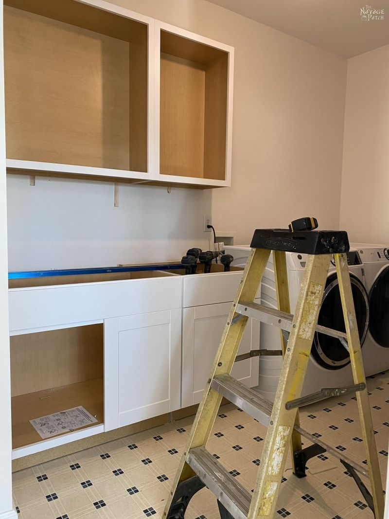 installing cabinets in a laundry room