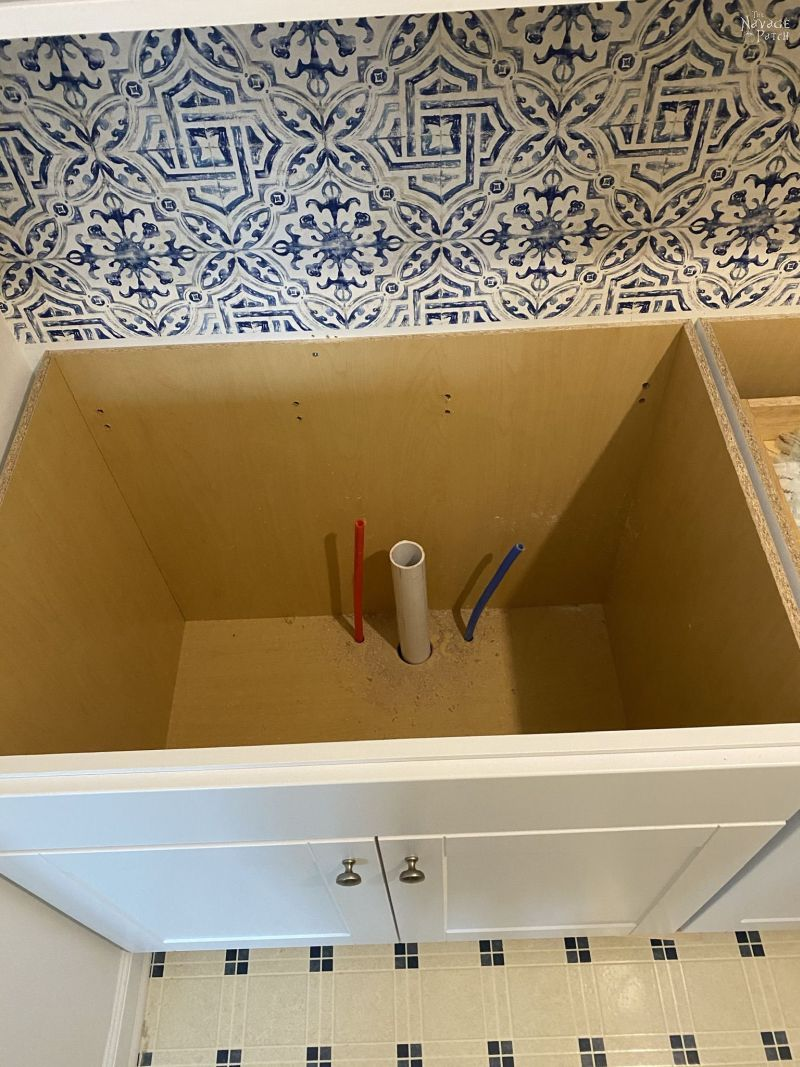 newly installed drain pipes in a cabinet