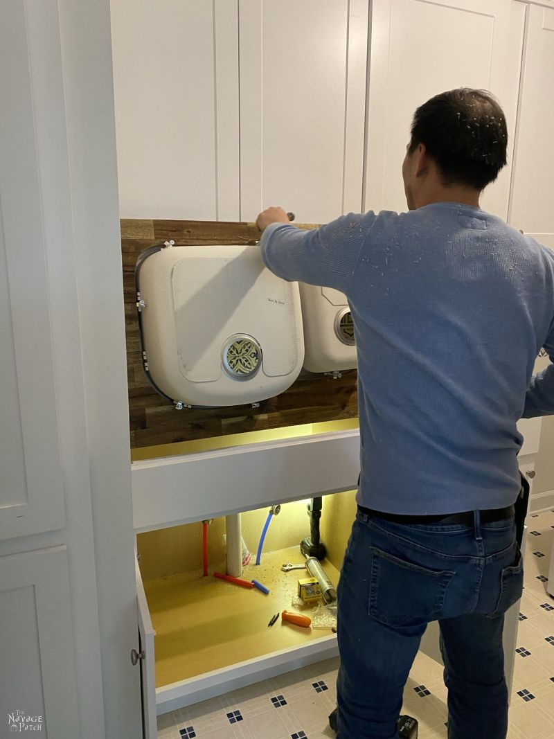 installing a sink and countertop in a laundry room