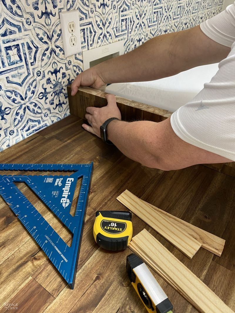 gluing a countertop support in place