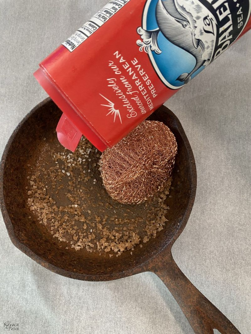 cleaning a rusty cast iron pan with salt