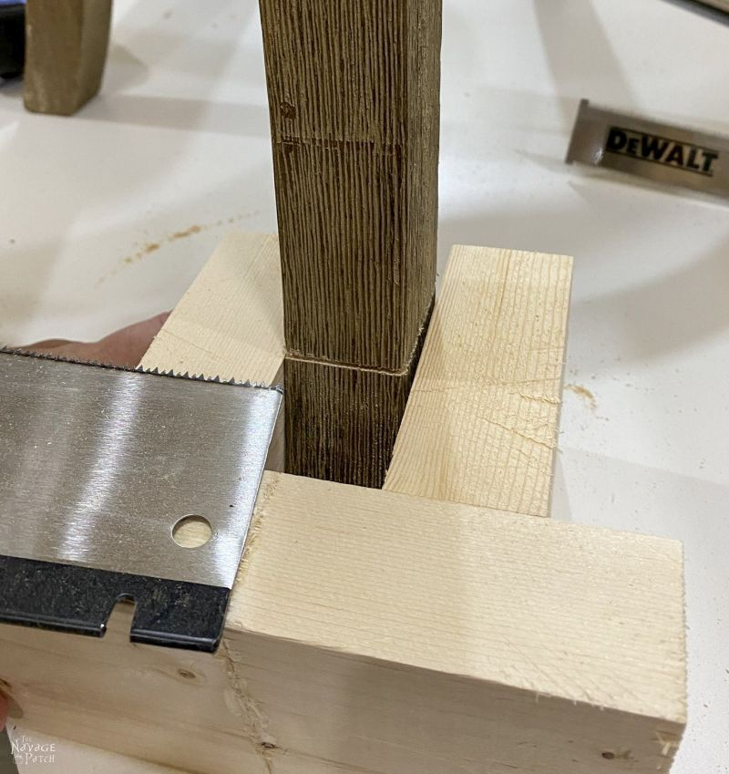 using a flush cut saw on a barstool leg