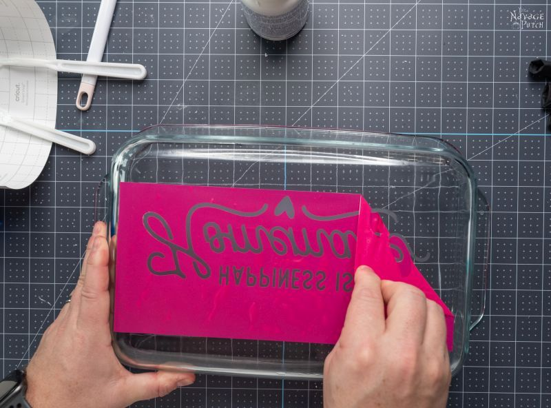 peeling a stencil from an etched baking dish