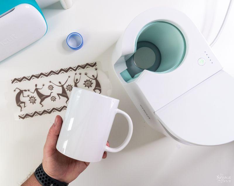 preparing a mug for cricut mug press