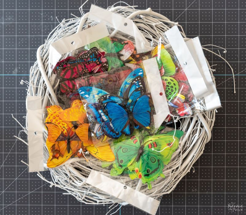 plastic butterflies and a wreath form