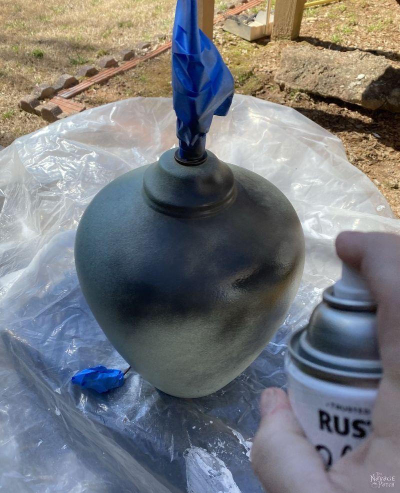 spraying an old lamp black