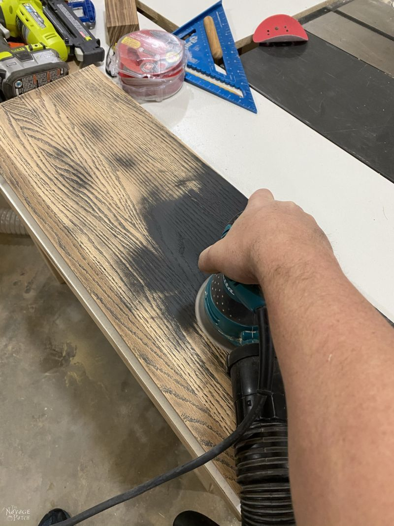 sanding a coat closet shelf
