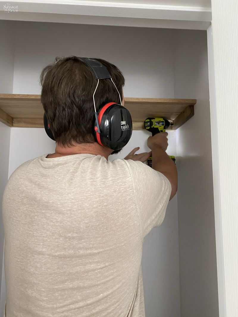 installing a coat closet shelf
