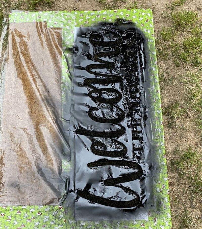spraying plasti dip on a mat