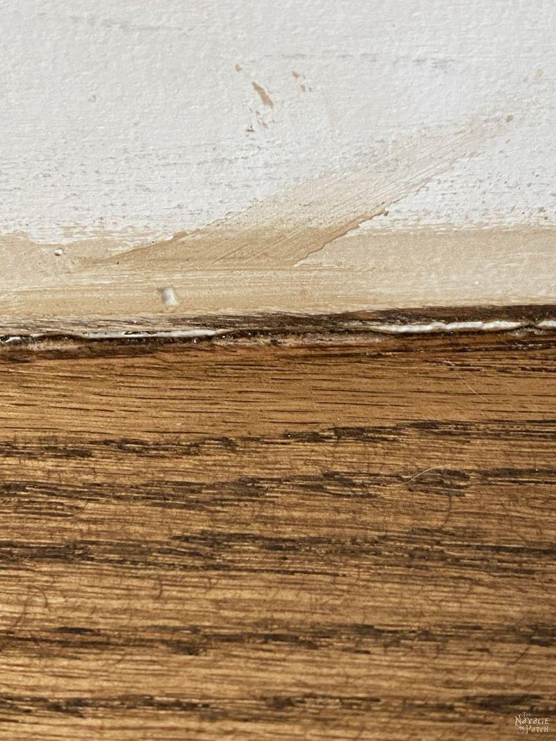 wood stair meeting a riser