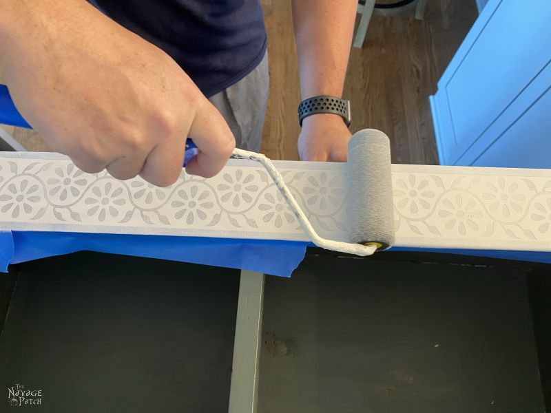 painting faux indian bone inlay stencils on a living room cabinet