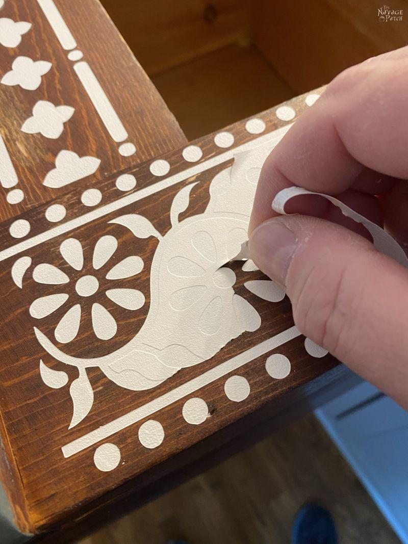 peeling a faux Indian bone inlay stencil