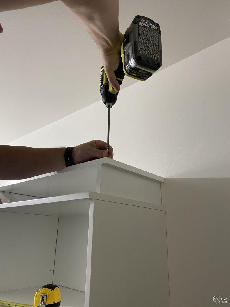 installing a shelf in a master closet